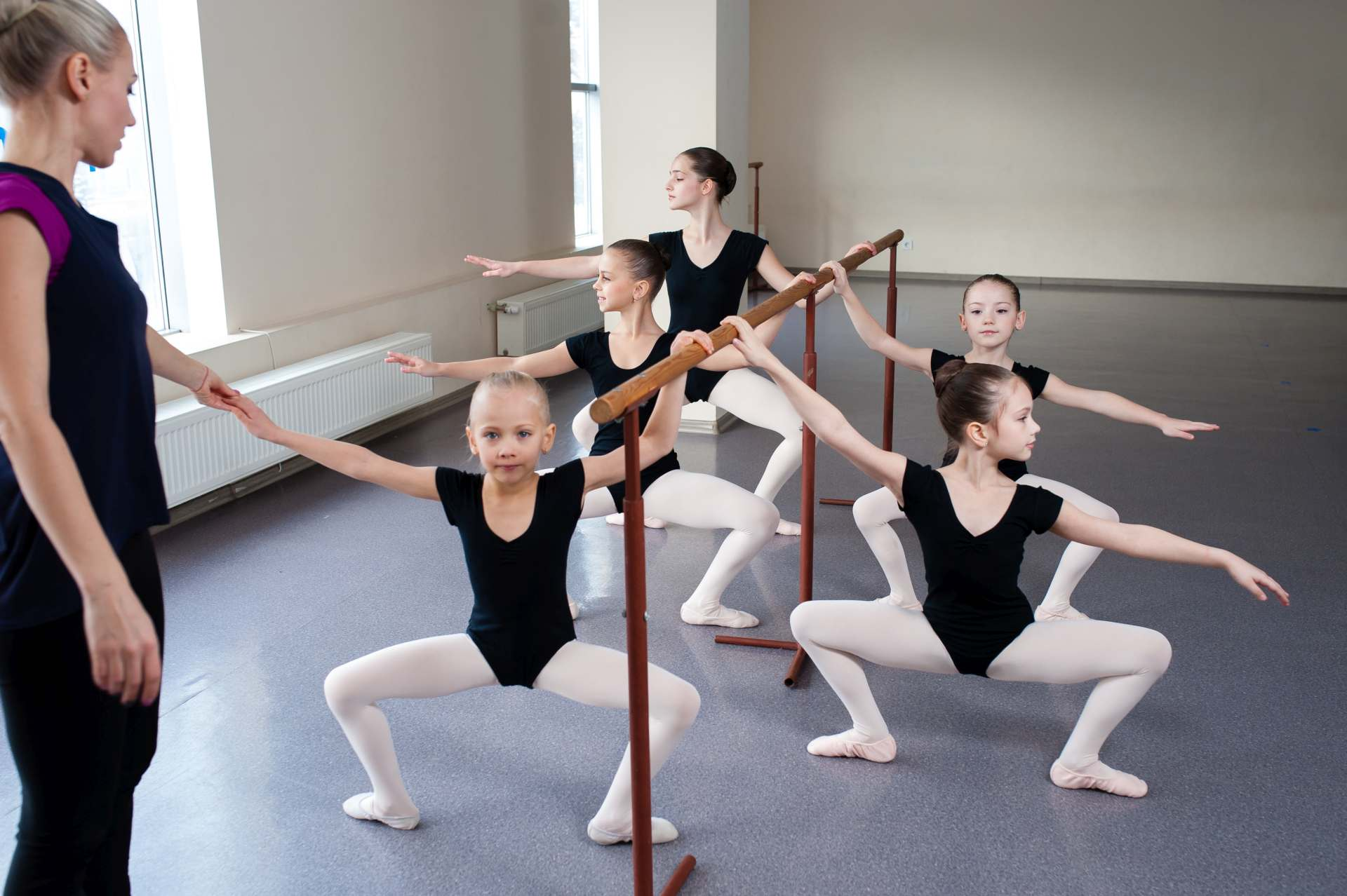 Children are taught ballet positions