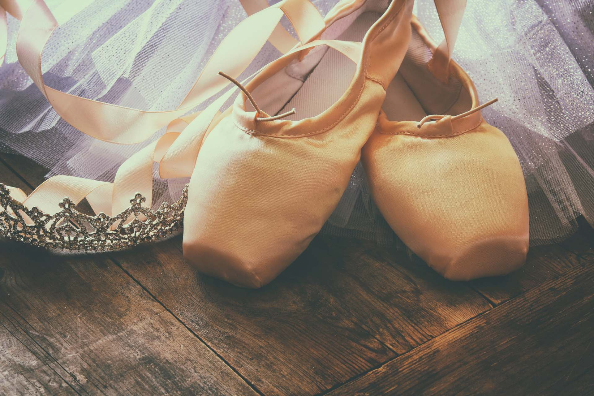 Silk Pointe Shoes on Wooden Floor